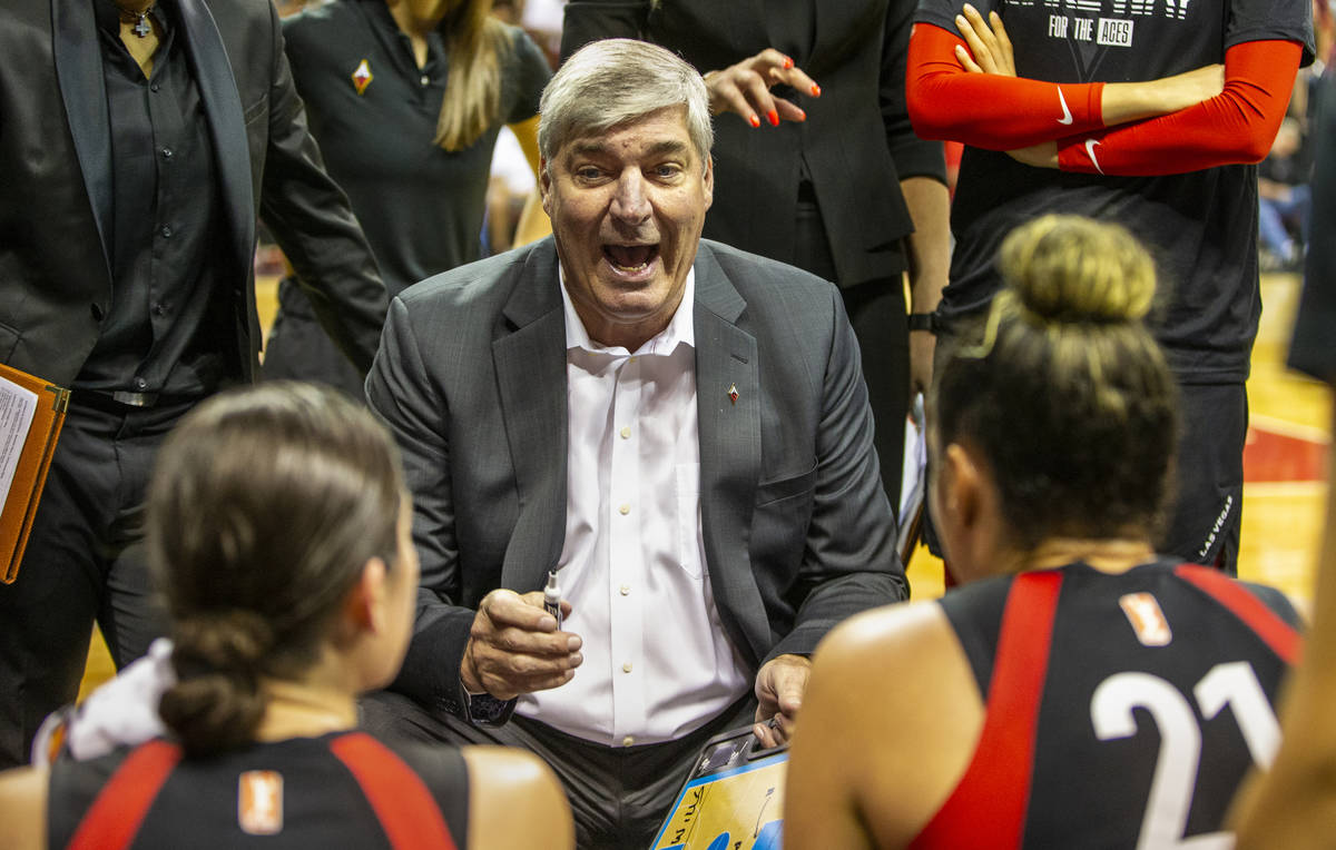 Las Vegas Aces head coach Bill Laimbeer talks up his players in a huddle during a timeout as th ...