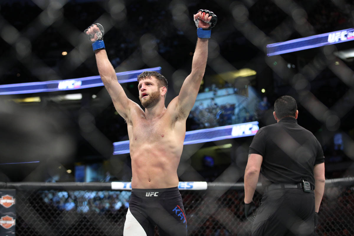 Calvin Kattar, left, celebrates after defeating Andre Fili in the featherweight bout during UFC ...