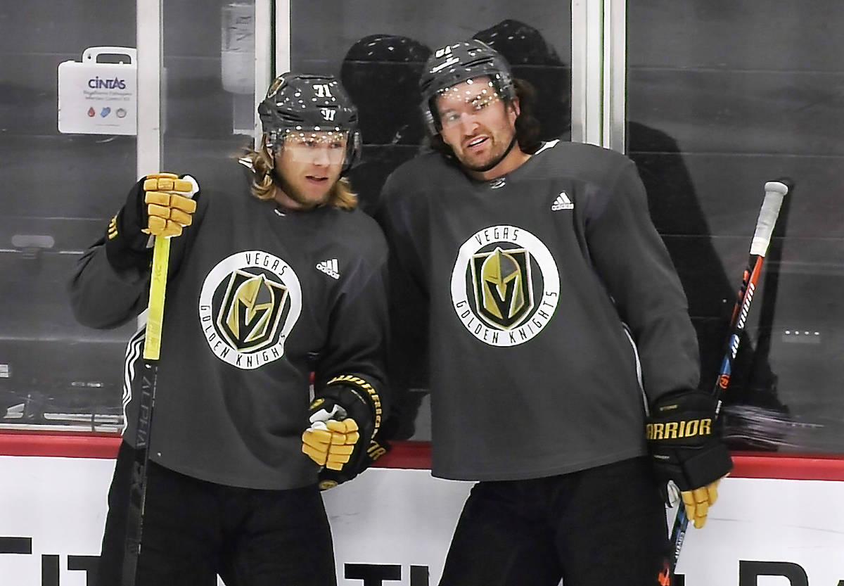 Vegas Golden Knights center William Karlsson (71), left, talks with right wing Mark Stone (61) ...