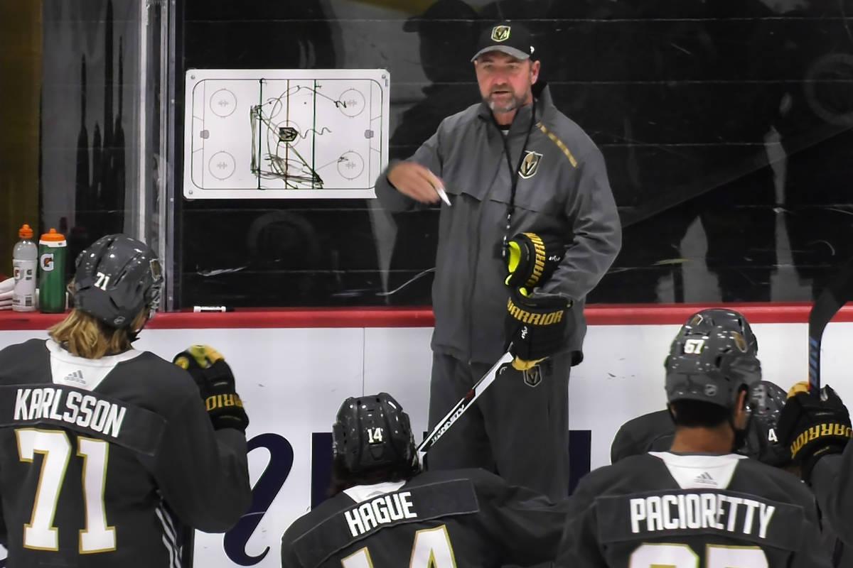 Vegas Golden Knights coach Peter DeBoer talks with center William Karlsson, defenseman Nicolas ...