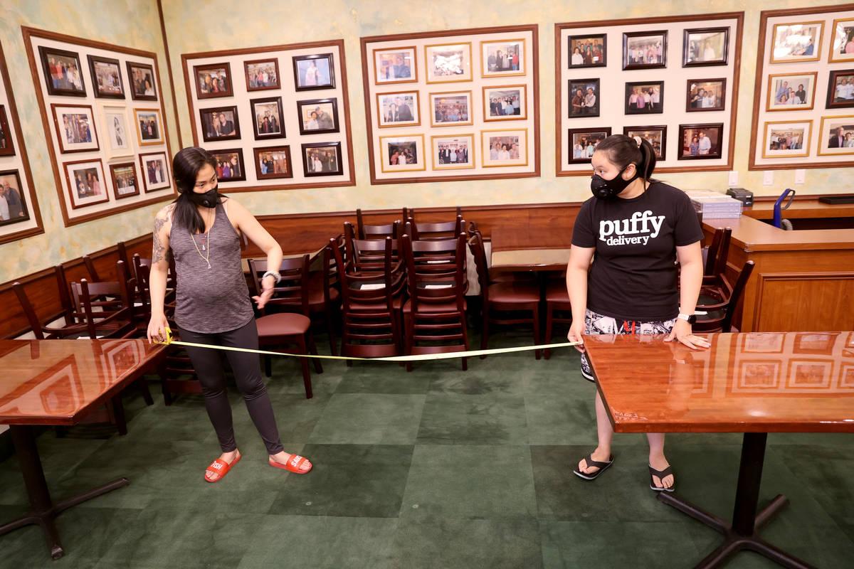 Penny Chutima, left, and her sister Sabrina Churima, whose family owns Lotus of Siam, measure t ...