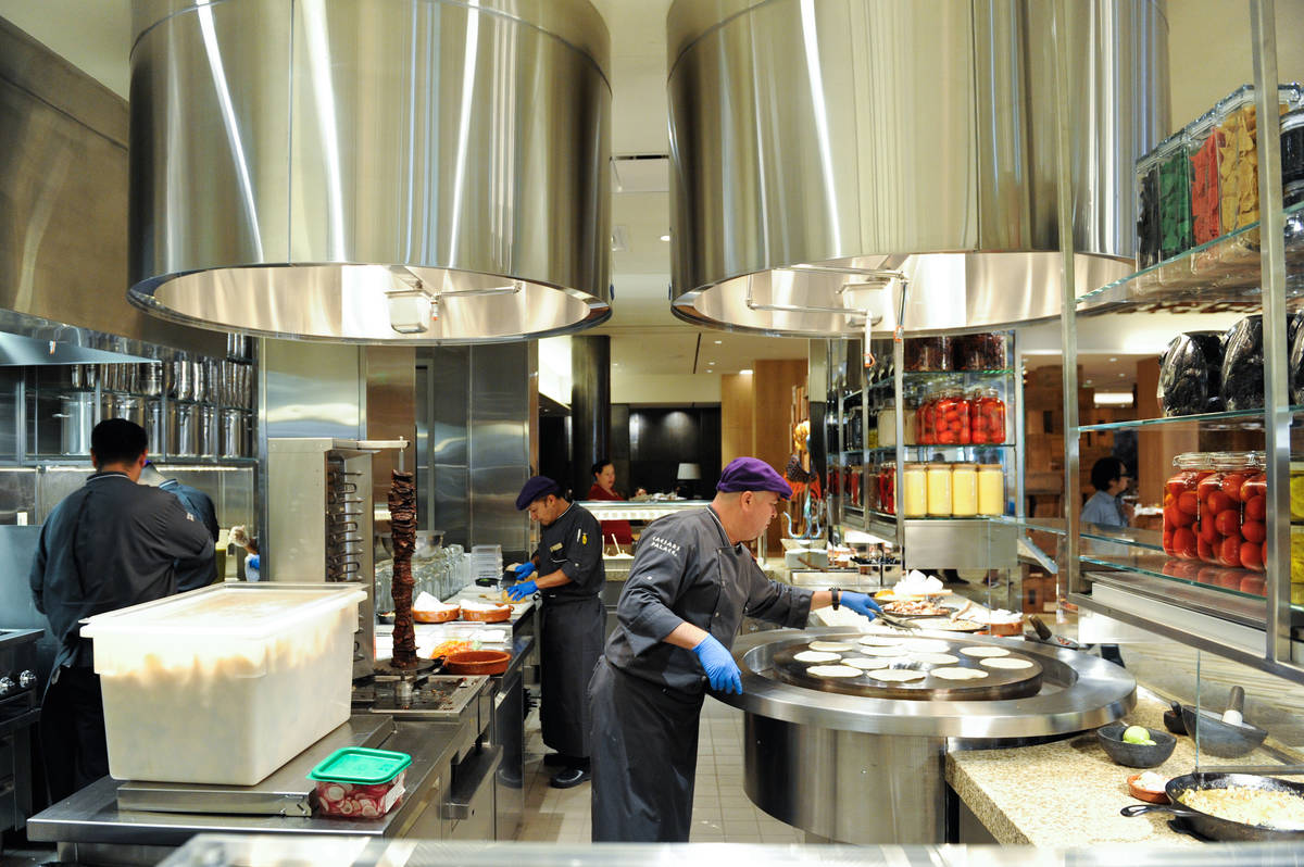 Chefs prepare food in the Mexican kitchen of the Bacchanal Buffet at Caesars Palace, 3570 Las V ...