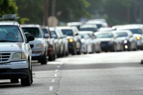 People wait in their vehicles in line at a COVID-19 testing site, Tuesday, July 14, 2020, in Ho ...