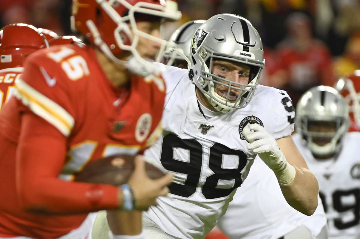 Oakland Raiders defensive end Maxx Crosby (98) chases Kansas City Chiefs quarterback Patrick Ma ...