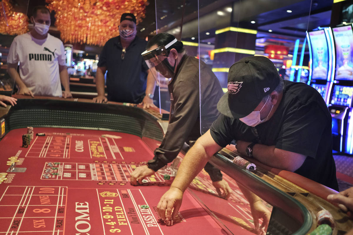 Craps players and dealers are seperated by partitions at the Golden Nugget Casino in Atlantic C ...