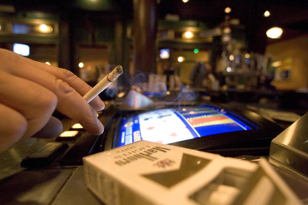 A smoker at a video poker machine in Las Vegas. (K.M. Cannon/Las Vegas Review-Journal)