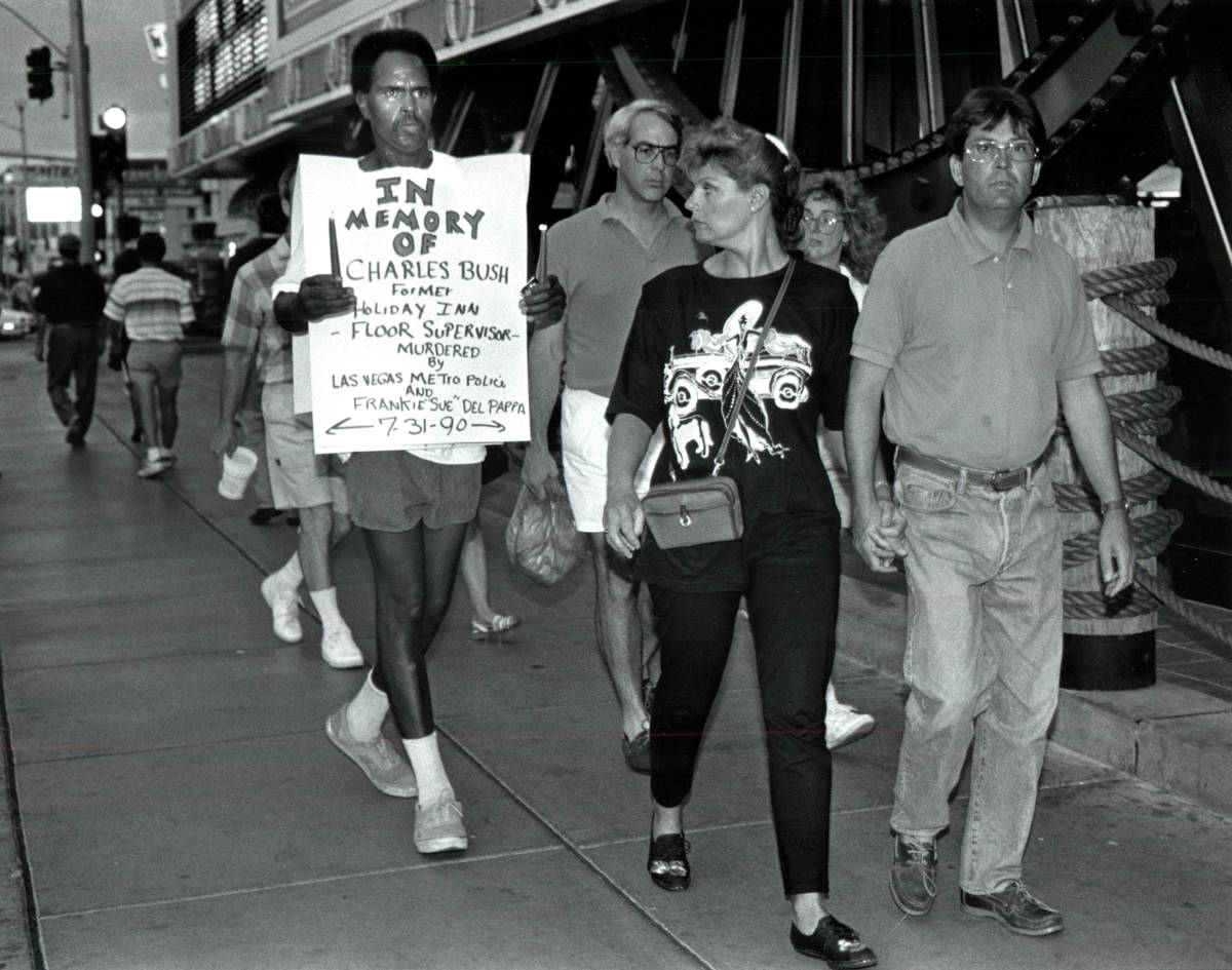 Sekou Kala, left, marches during a solitary vigil in memory of Charles Bush in 1990. (Las Vegas ...