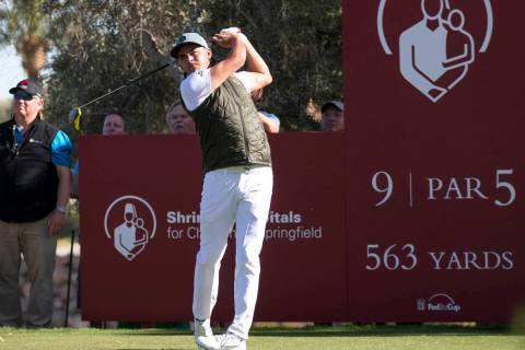 Rickie Fowler watches his drive from the ninth tee box during the first round of the Shriners H ...