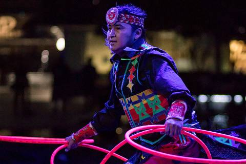 In this Aug. 10, 2018, photo provided by Anderson Gould Jr. shows hoop dancer Nakotah LaRance p ...
