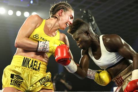 Mikaela Mayer, left, connects to the midsection of Helen Joseph during their junior lightweight ...