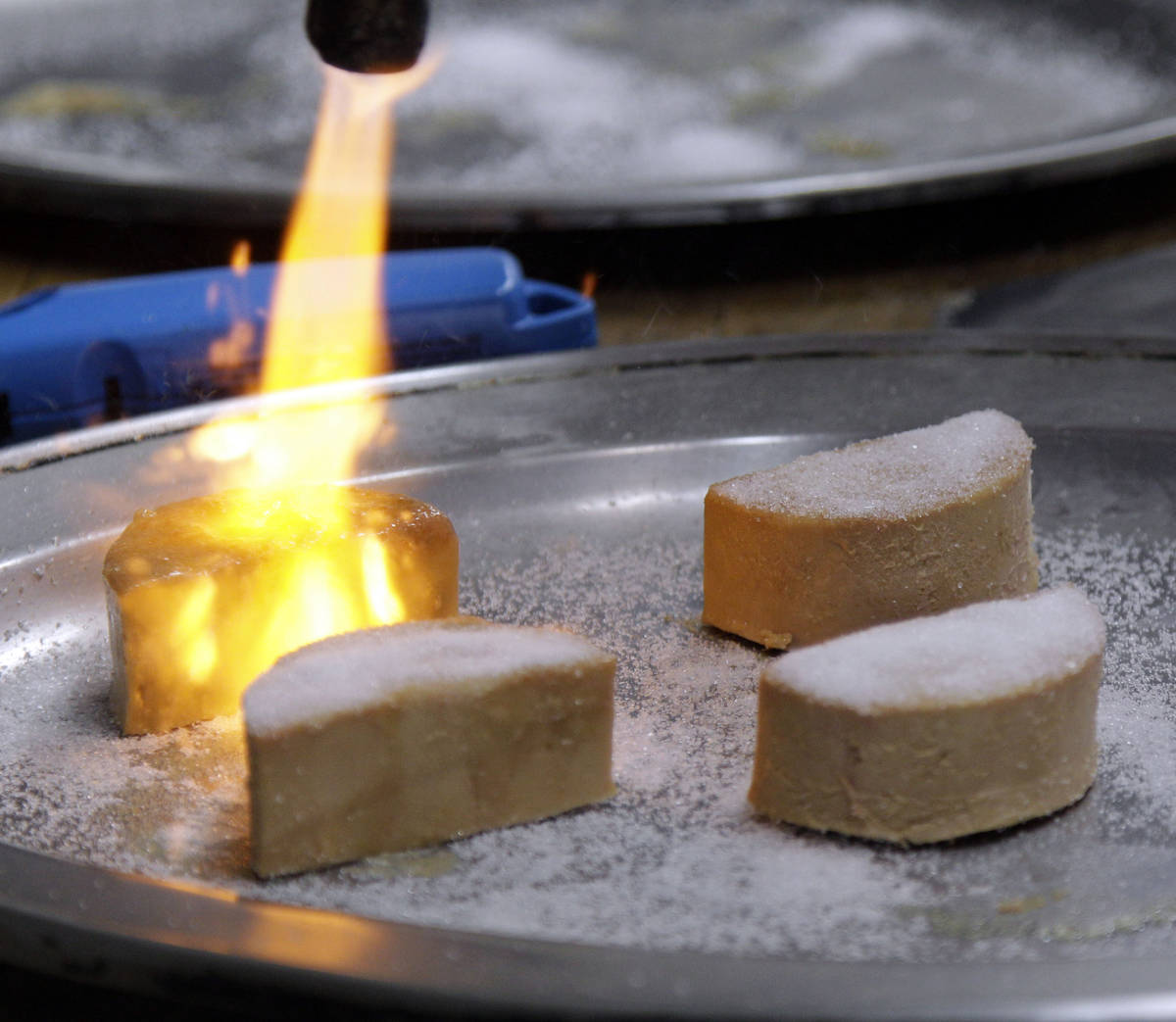 FILE - In this Friday, May 11, 2012, file photo, Foie Gras is torched and made into a Brulee at ...