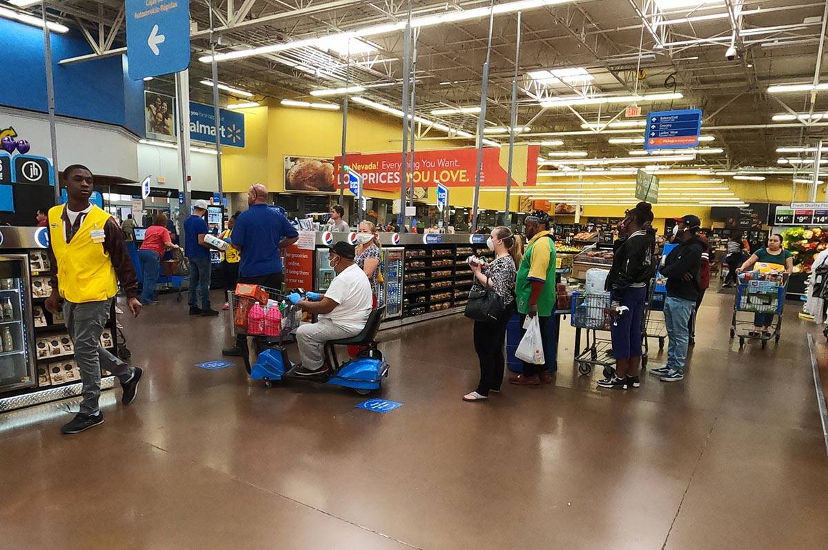 People line up to pay at the Walmart Supercenter, 3950 W Lake Mead Boulevard in North Las Vegas ...