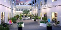 The downtown apartment complex, ShareDowntown, offers common places for residents to work and r ...