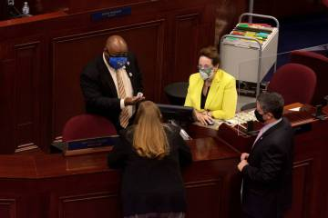From left, Nevada Speaker of the Assembly Jason Frierson, Assemblywoman Maggie Carlton, Chief ...
