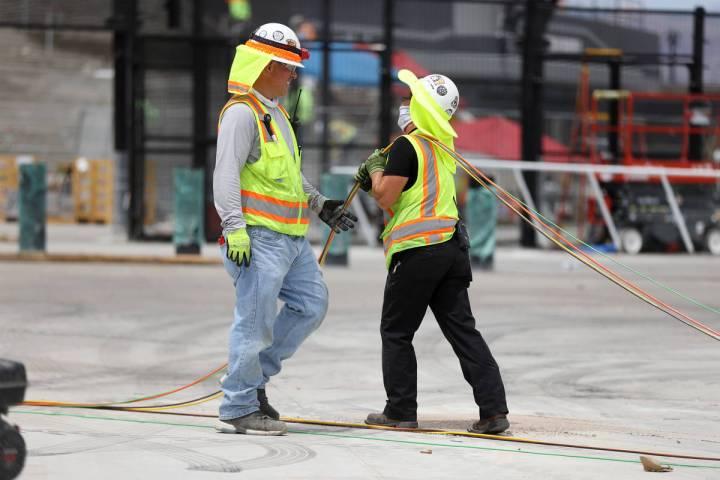 Workers deal with the heat Saturday, July 11, 2020, at Allegiant Stadium in Las Vegas. (Erik Ve ...