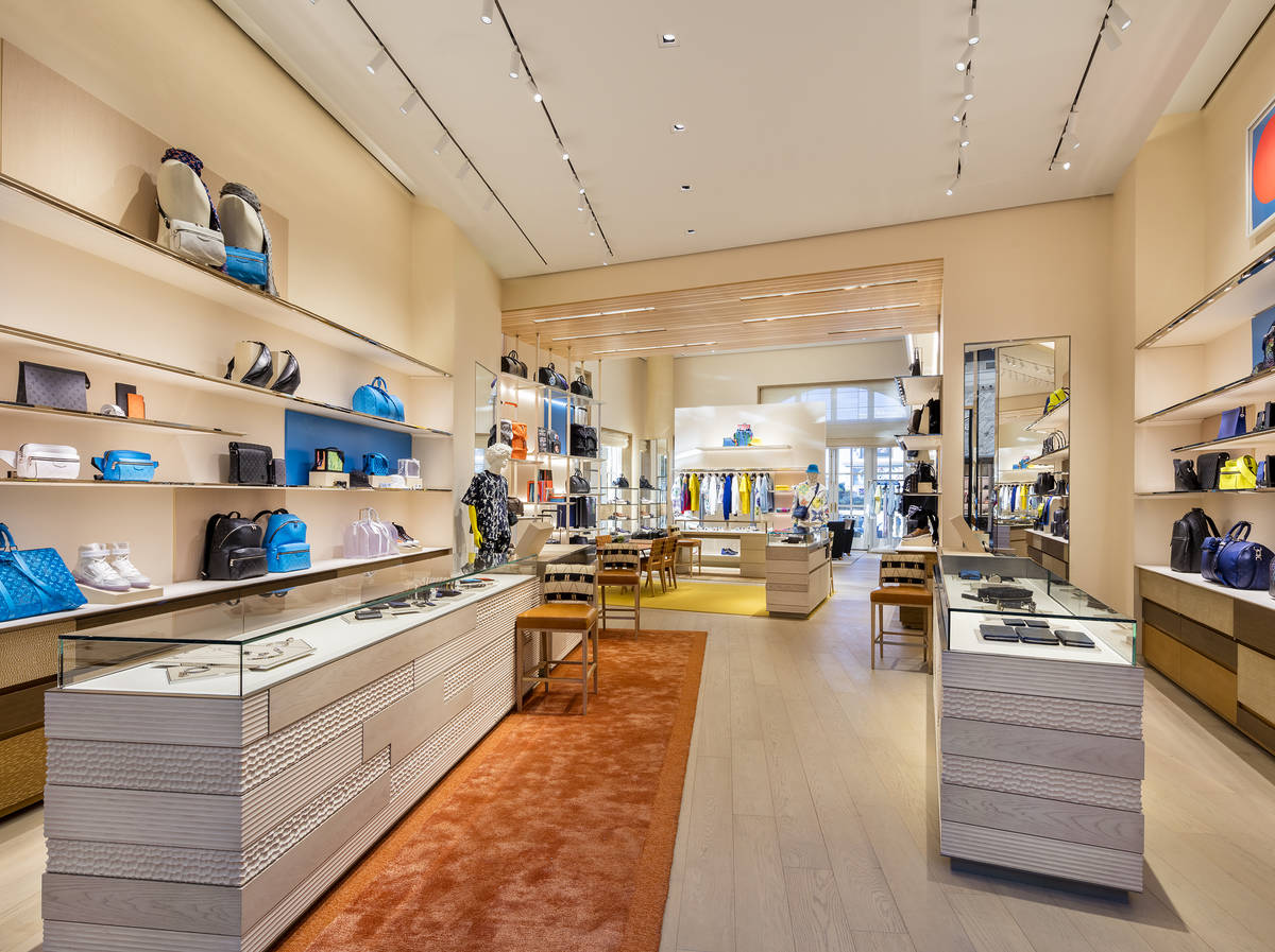 The store features floor to ceiling windows, leather shelves, wood ceilings and a unique design ...