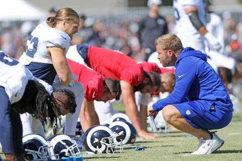 Los Angeles Rams outside linebacker Clay Matthews (52), left, has a discussion with head coach ...