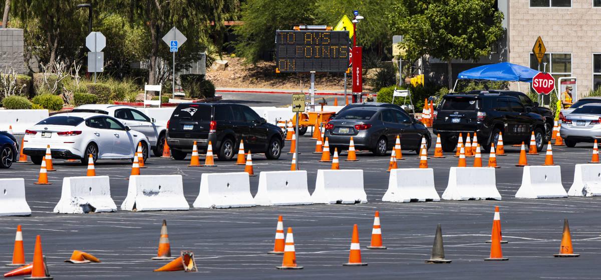 People line up at the UNLV coronavirus testing site in Las Vegas on Thursday, July 16, 2020. (C ...