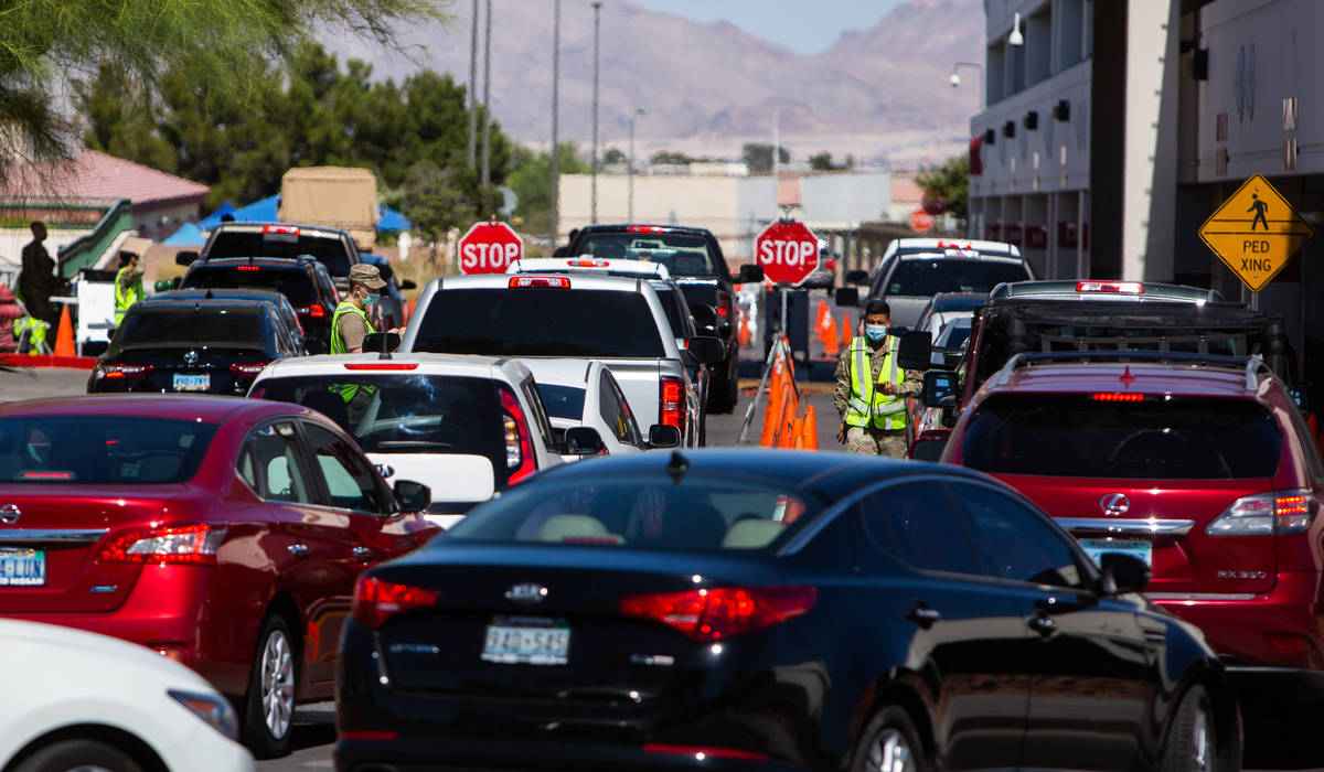 People line up for a coronavirus testing site at Texas Station in Las Vegas on Thursday, July 1 ...