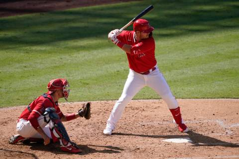 Los Angeles Angels center fielder Mike Trout bats during an intrasquad game at baseball practic ...