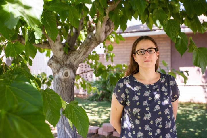 Lisa Hack, the business manager for the Nevada Broadcasters Association, stands outside her hom ...