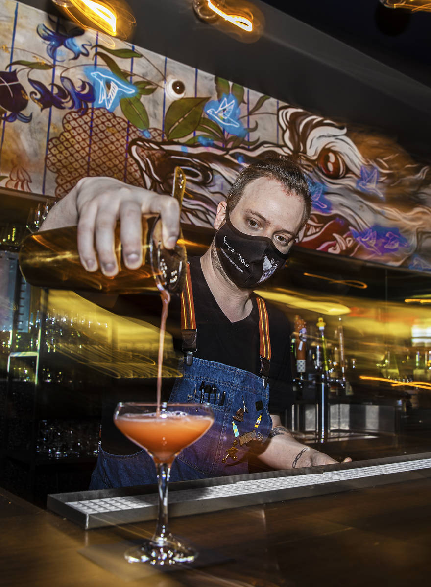 Bartender Ilan Miller makes a cocktail at Sparrow + Wolf on Tuesday, July 14, 2020, in Las Vega ...