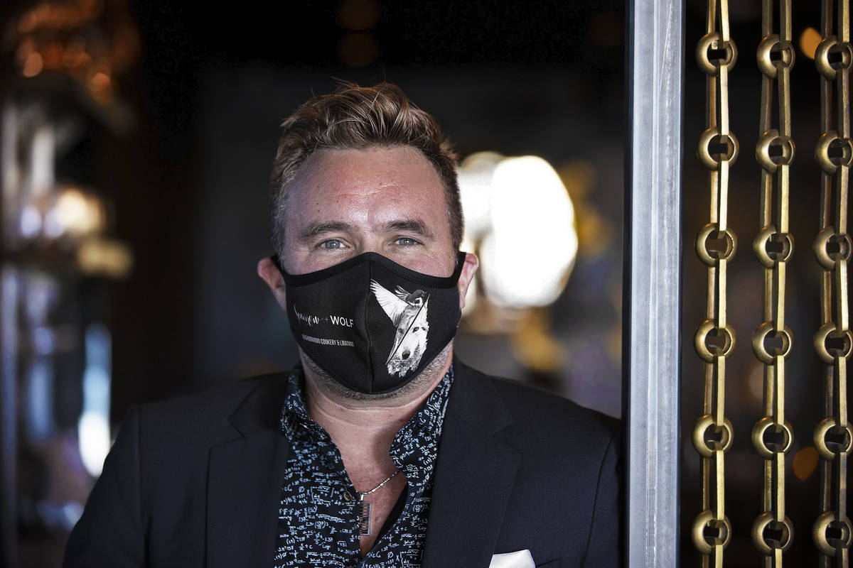 Business partner John Anthony wears a custom face mask at Sparrow + Wolf on Tuesday, July 14, 2 ...