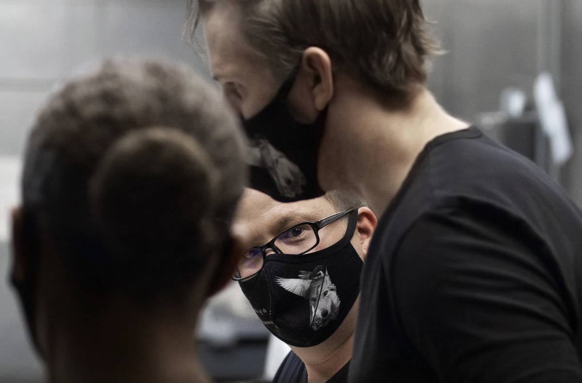 Chef/owner Brian Howard, middle, works in the kitchen wearing a custom face mask at Sparrow + W ...
