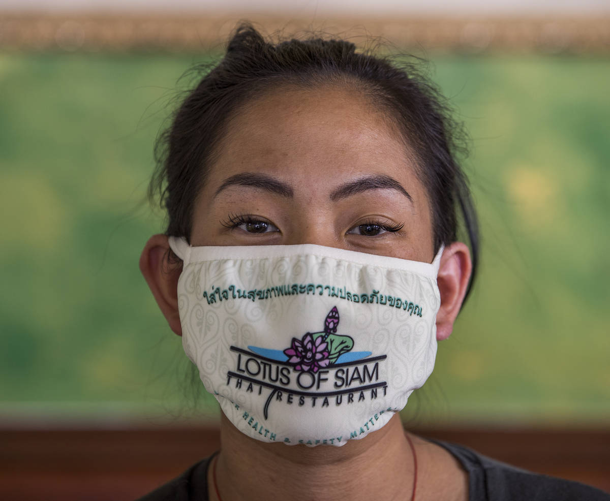 Penny Chutima at Lotus of Siam with custom mask on Wednesday, July 15, 2020, in Las Vegas. (L. ...