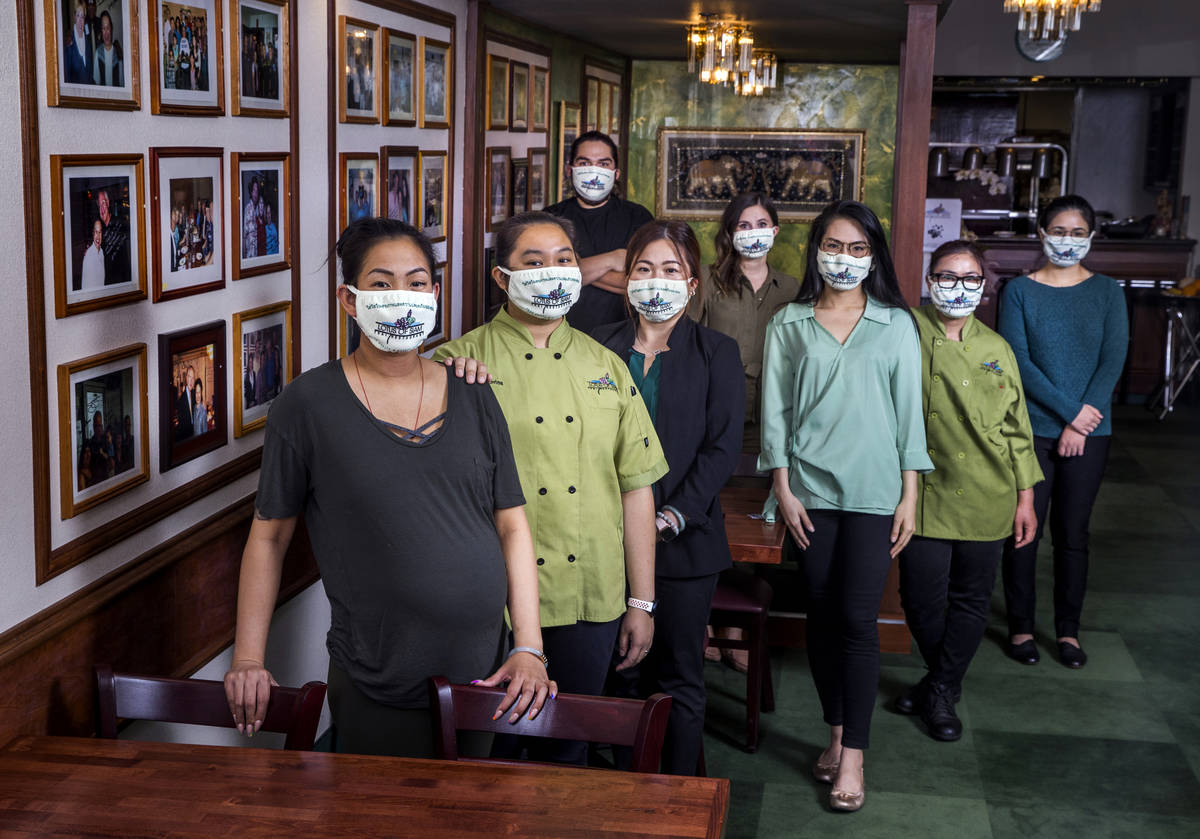 Penny Chutima, left, and sister Sabrina, behind her, joined by other staff members at Lotus of ...