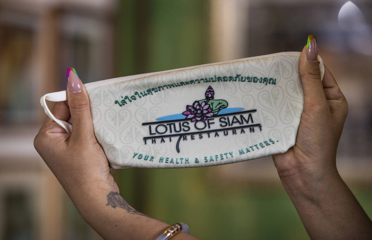 Penny Chutima at Lotus of Siam shows off a custom mask on Wednesday, July 15, 2020, in Las Vega ...