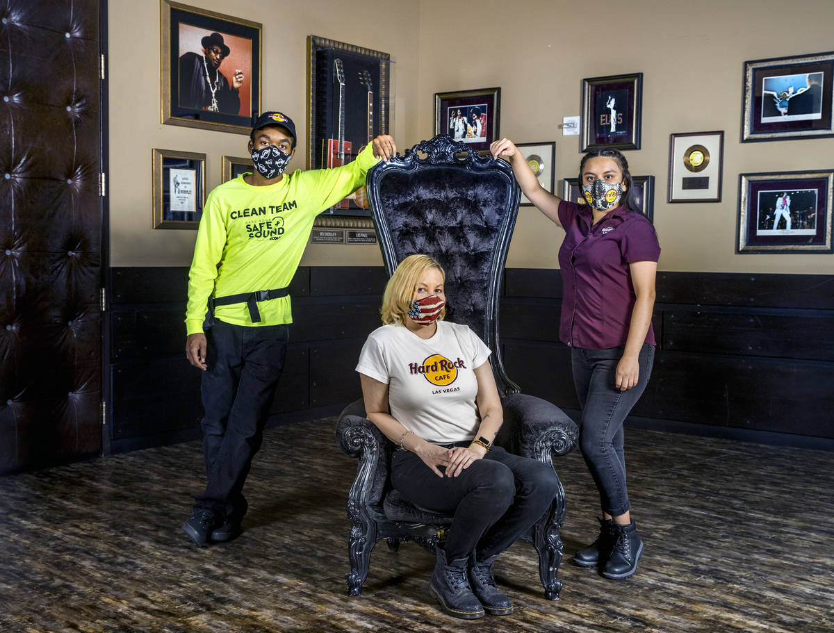 Mykel Lewis, left, Kristin McCormick, center, and Gloria Reyes at the Hard Rock Cafe wearing th ...