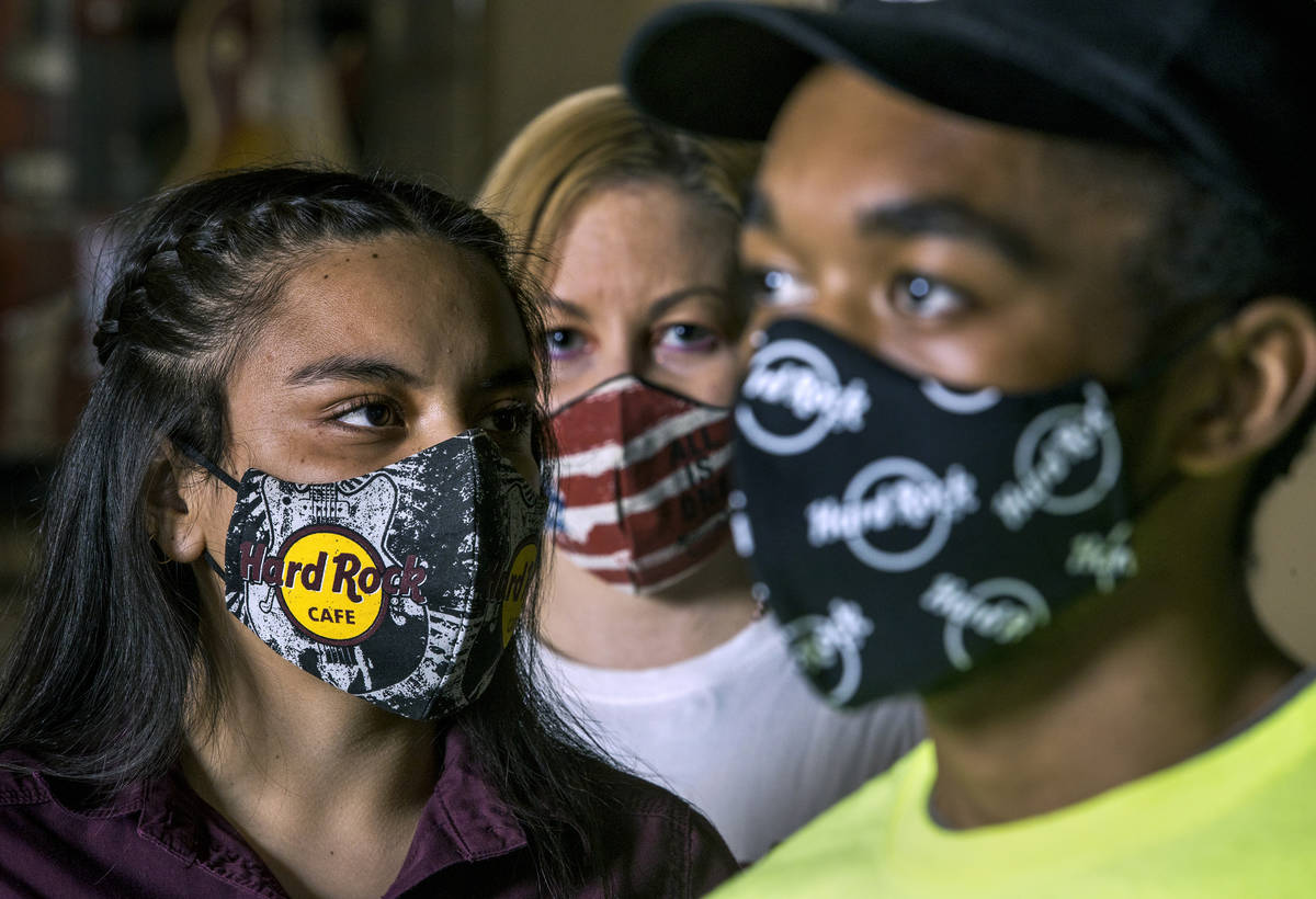 Gloria Reyes, left, Kristin McCormick, center, and Mykel Lewis at the Hard Rock Cafe wearing th ...