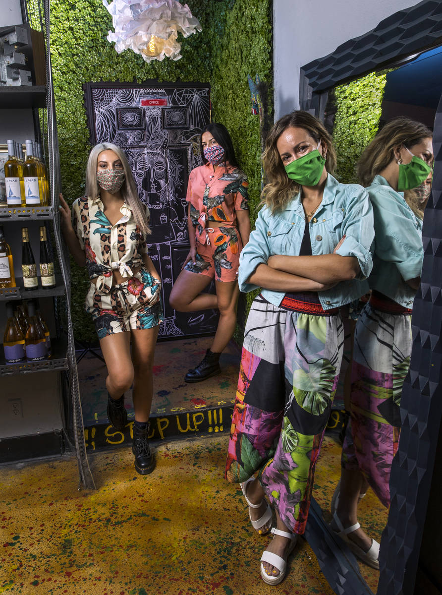 Nina Manchev, right, Andjela Velkov, center, and Kristina Stamenkovic with masks at Forte Tapas ...
