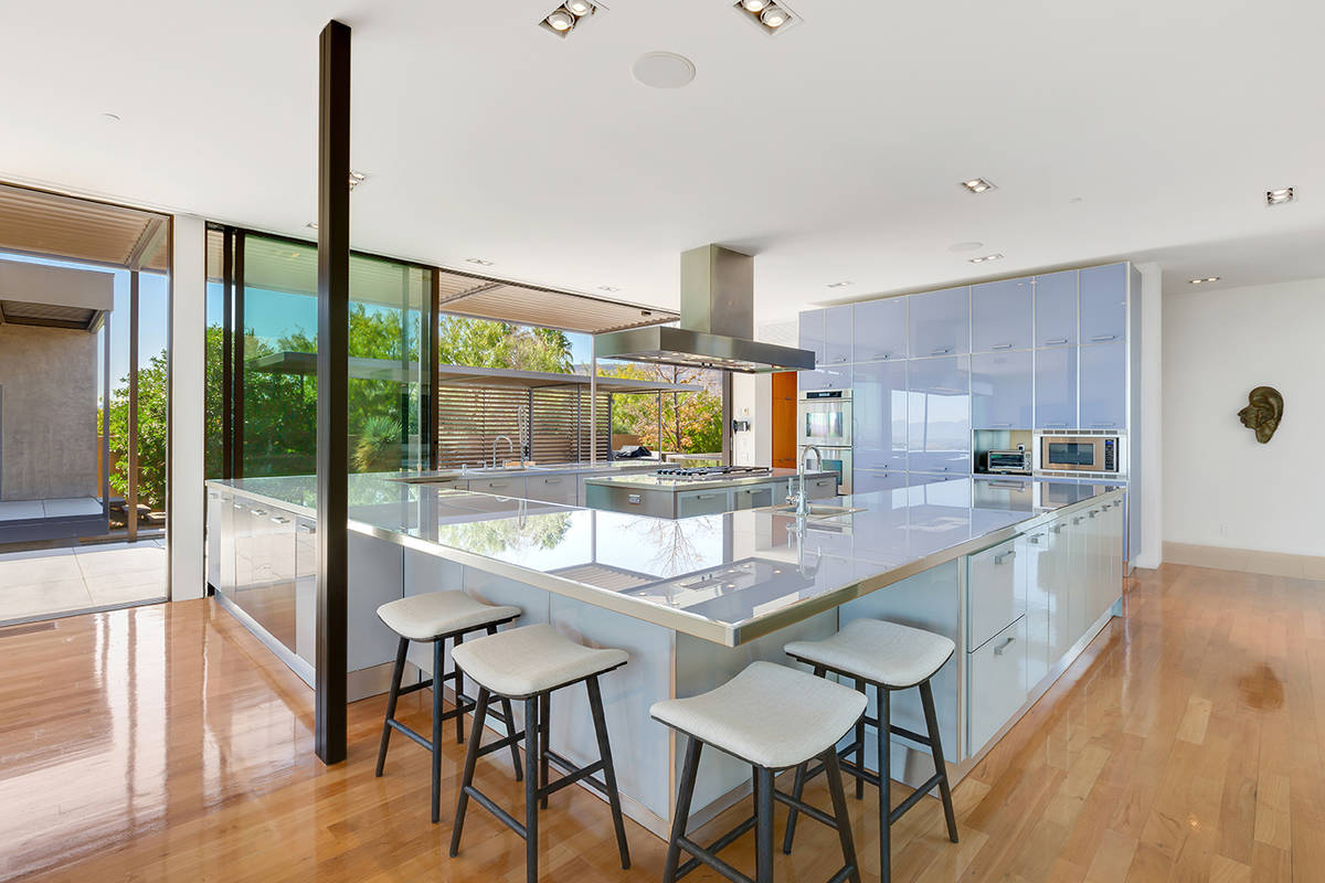 The home has a Scavolini luxury Italian kitchen surrounded by floor-to-ceiling windows. (Ivan S ...