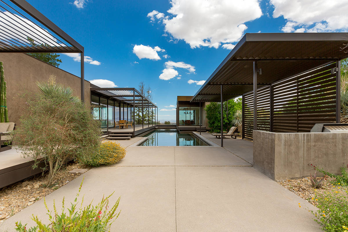 The home at 7 Painted Feather Way was created by world-renowned architecture firm Marmol Radzin ...