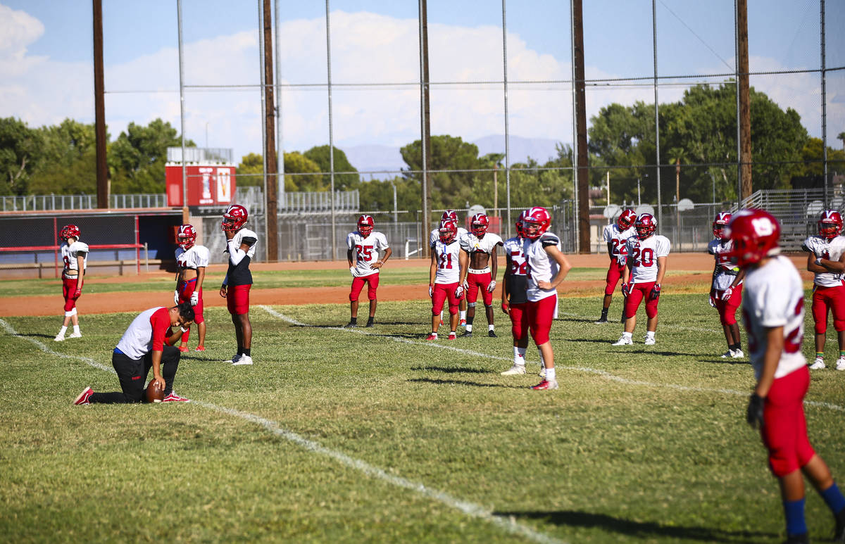 Players during footballl practice at the baseball field at Valley High School in Las Vegas on W ...