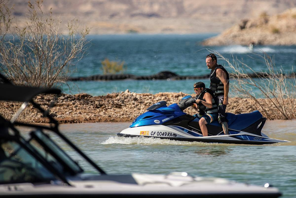 People enjoy jet skiing and boating at Lake Mead on Saturday, June 20, 2020, in Boulder City. ( ...