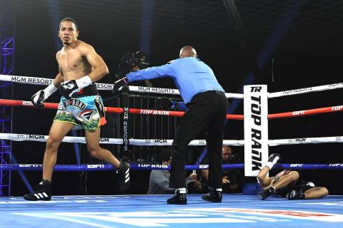 Felix Verdejo heads to his corner after knocking out Will Madera in the first round of their li ...
