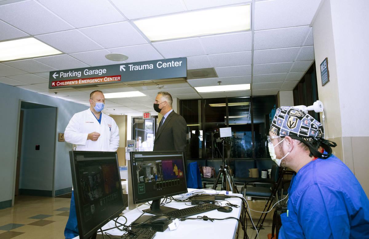 University Medical Center CEO Mason VanHouweling, center, discusses the hospital's patient volu ...