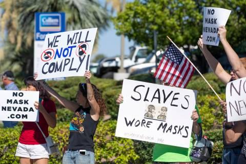 """A """"No Mask Protest"""" occurs at the intersection of West Sunset Road and North Stephani ..."""