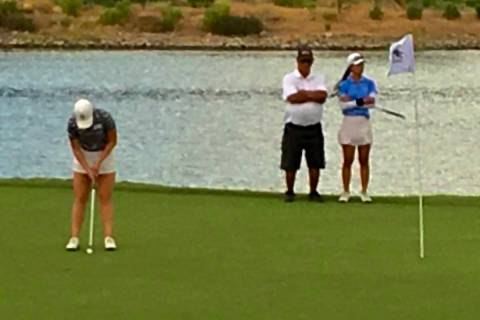 Morgan Goldstein putts on the 18th green to close out an eight-shot victory at the Nevada State ...