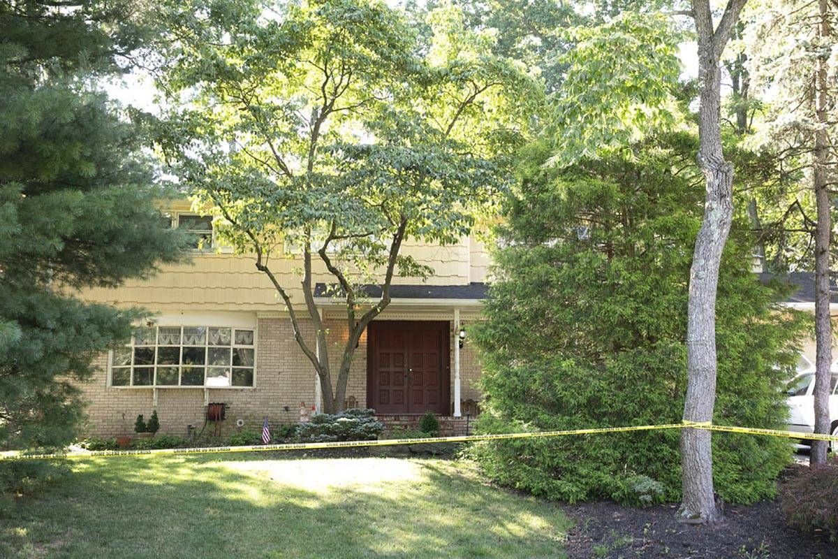 Crime scene tape surrounds the home of U.S. District Judge Esther Salas on Monday, July 20, 202 ...
