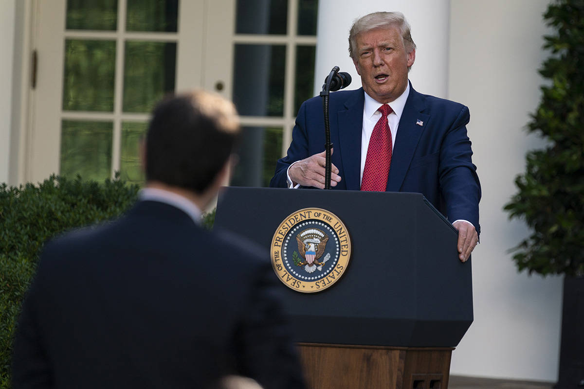 President Donald Trump speaks during a news conference in the Rose Garden of the White House, T ...