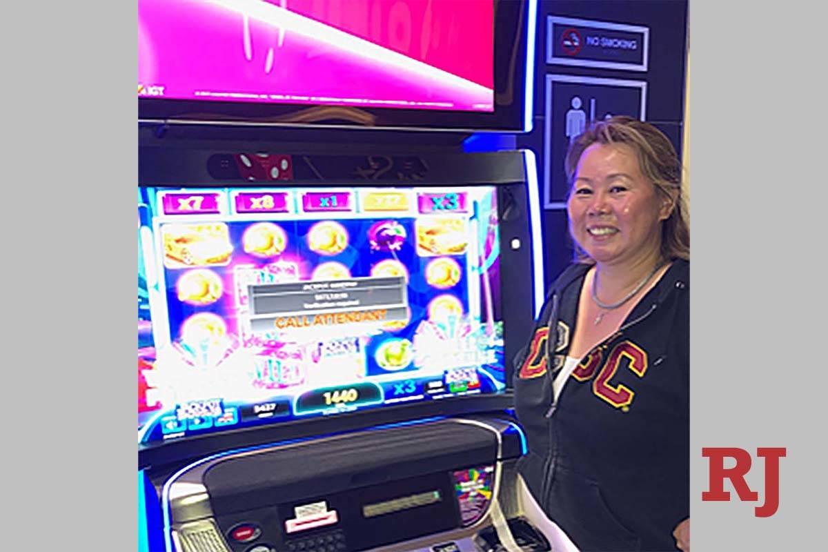 Kaoru H. of Torrance, Calif., hit a $873,511 jackpot at McCarran International Airport. (Photo ...