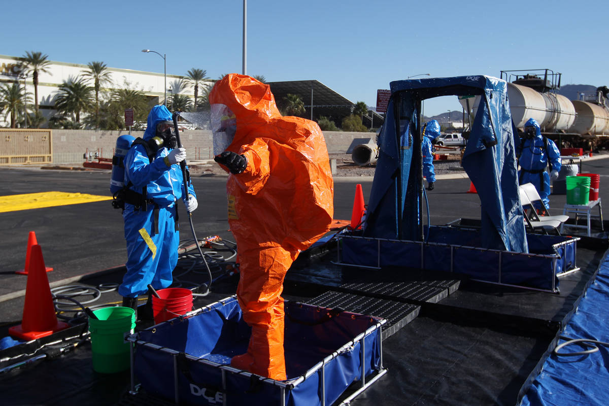 "Members of the Nevada National Guard's 92nd Civil Support Team are ""decontaminated"" d ..."