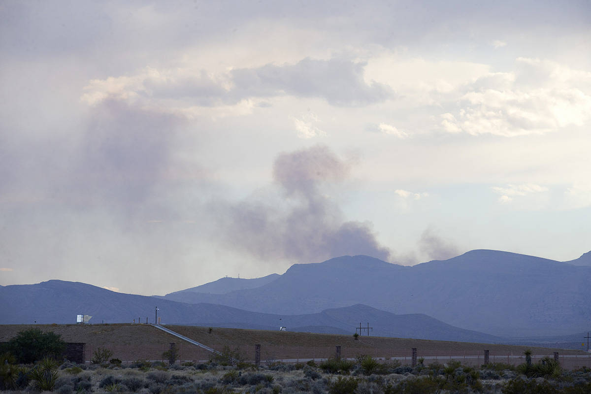 Smoke from the Cottonwood Fire peaks behind Mt. Potosi on Monday, July 20, 2020, in Las Vegas. ...