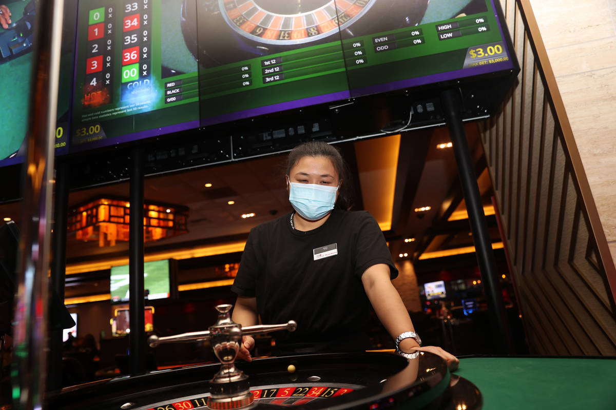 Table game dealer Xiumei Yu practices her throw on a roulette wheel at Palace Station Casino i ...