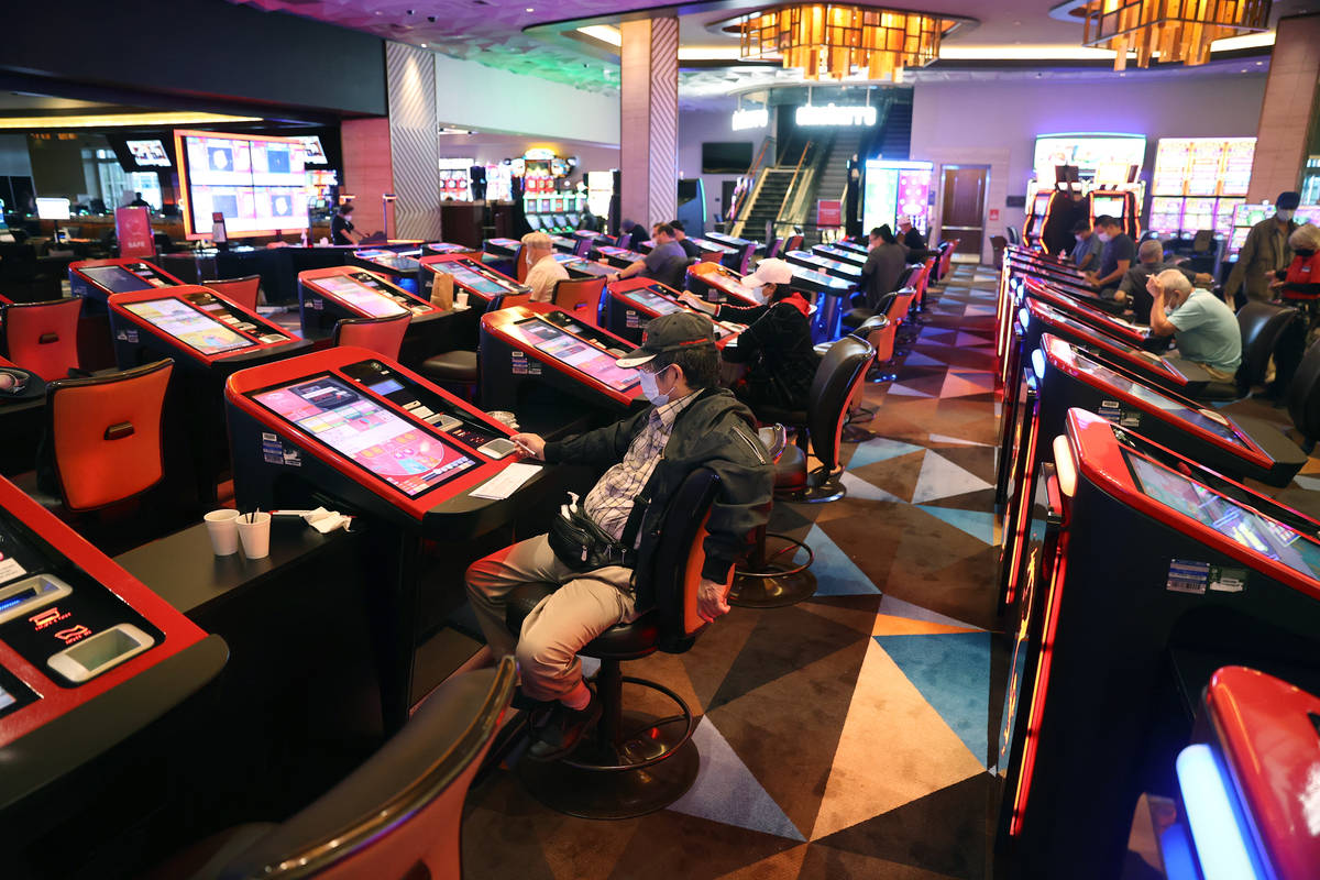 Customers play with digital baccarat gaming tables at Palace Station Casino in Las Vegas, Frida ...
