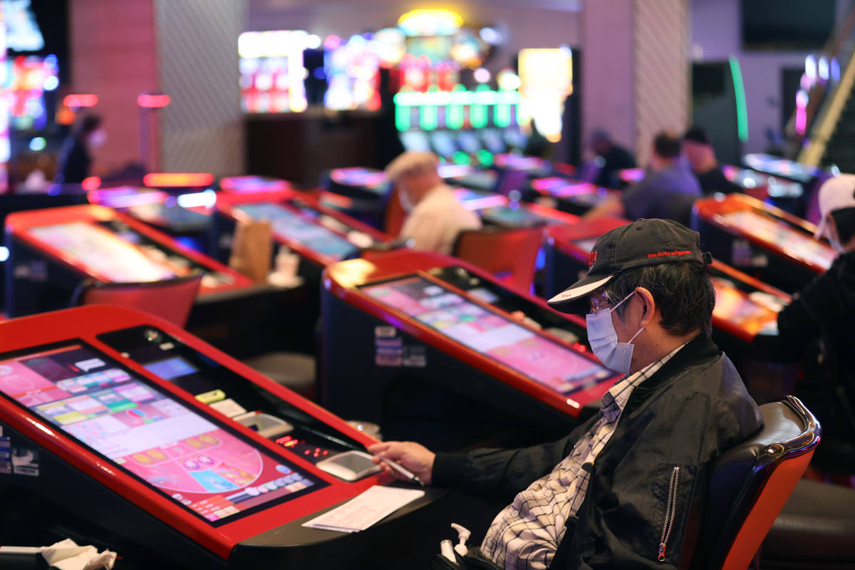 A customer plays with digital baccarat gaming tables at Palace Station Casino in Las Vegas, Fri ...